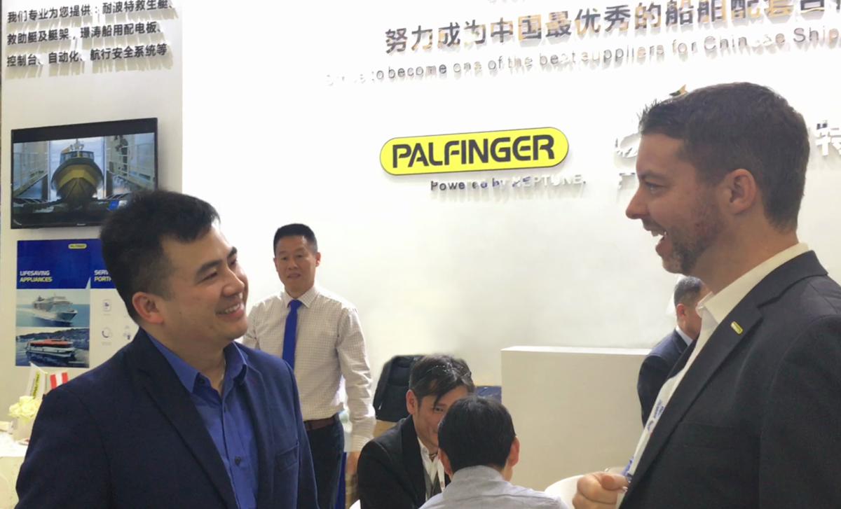 Ji Tang and Felix Strohbichler, member of PALFINGERs executive board, at Marintec China 2019, celebrating PALFINGER NEPTUNE's first public appearance.